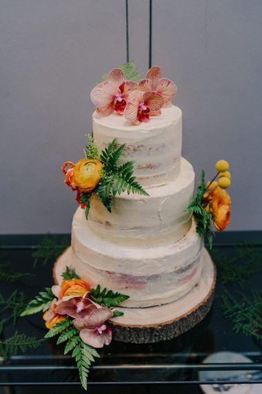 Semi-Naked Wedding Cake With Flower Decoration on Tree Slice