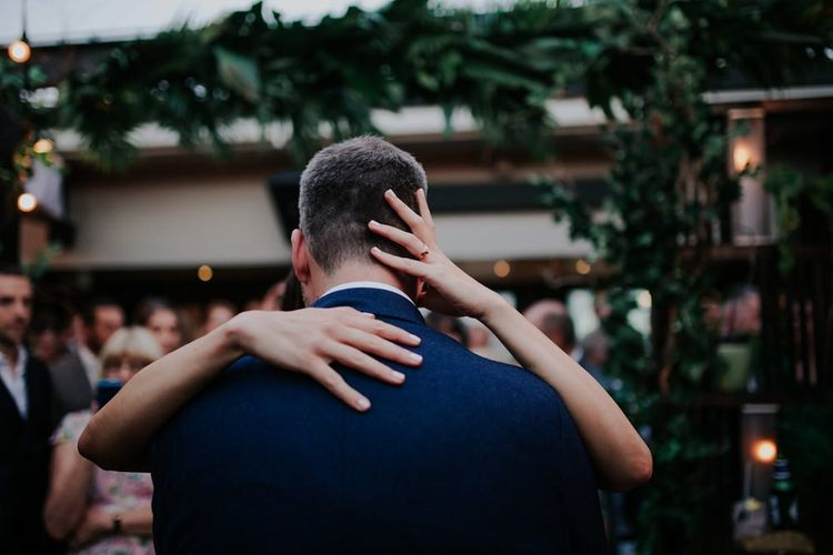 Bride And Groom Kiss On Dancefloor at Wedding Reception