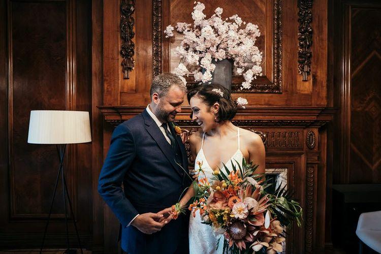 Bride Holding Orange Wedding Flowers Bouquet