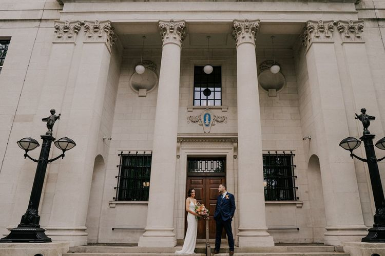 Bride and Groom Outside London Ceremony Venue