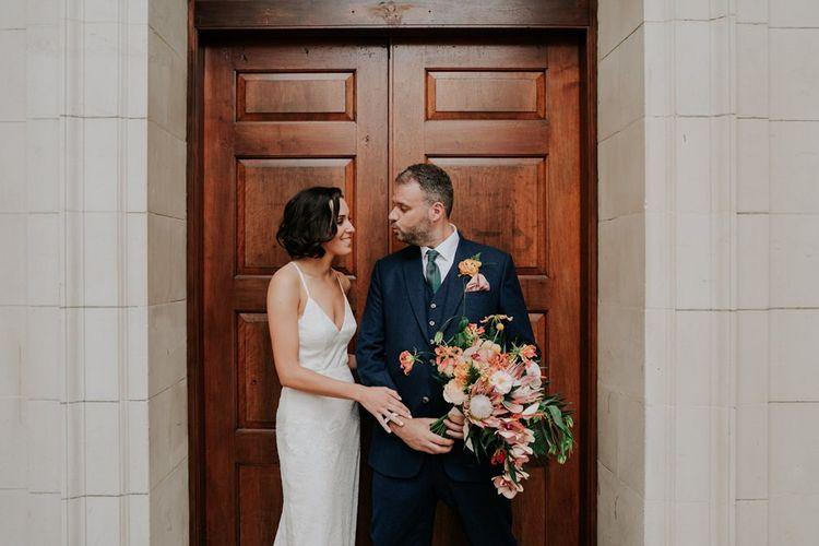 Charlie Brear Bride Dress With Orange Wedding Flowers