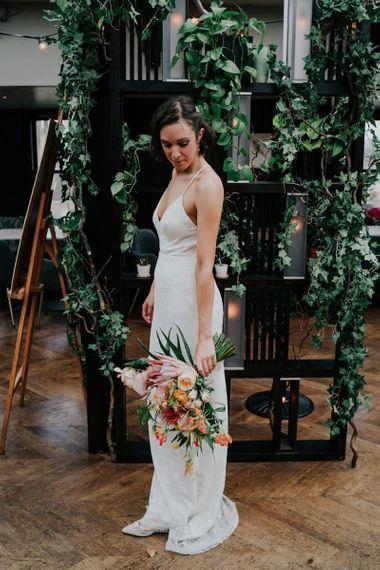 Lace Bridal Dress With Orange Wedding Glowers