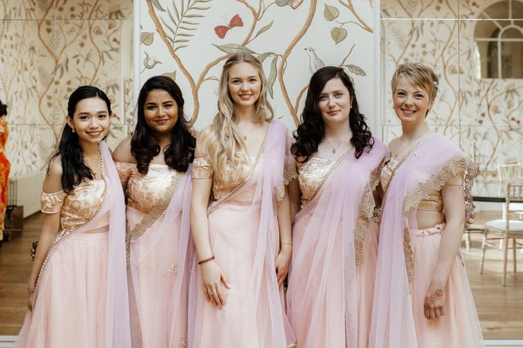 Pink sari for bridal party and navy Indian wedding dress for bride
