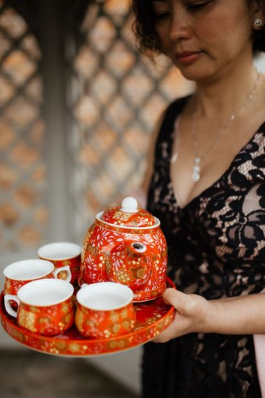 Traditional Chinese tea ceremony for fusion wedding with Indian wedding dress