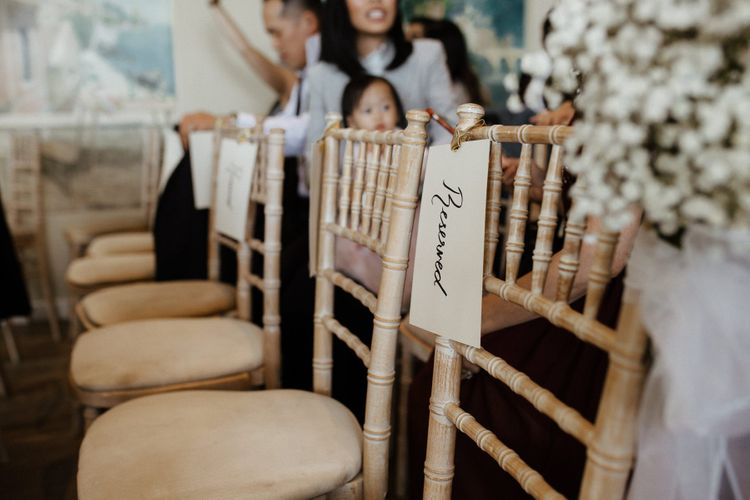 Wedding chairs with flower decor  during ceremony