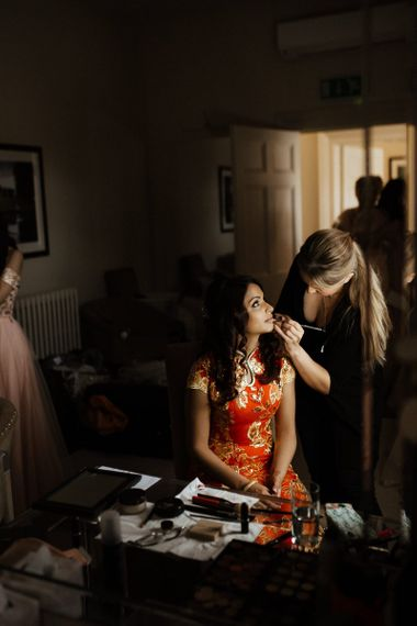 Bridal beauty before Chinese tea ceremony and outfit change to Indian wedding dress