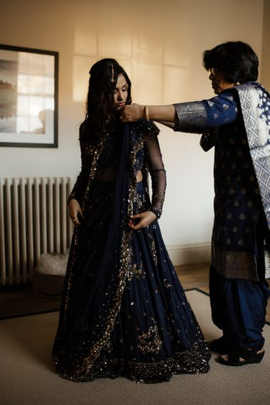 Bride changes into navy Indian wedding dress