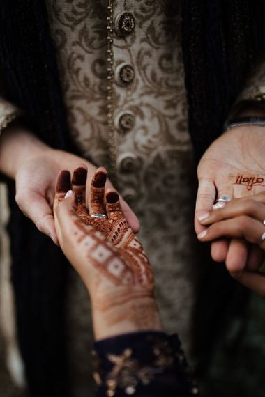 Bridal henna tattoo and navy Indian wedding dress