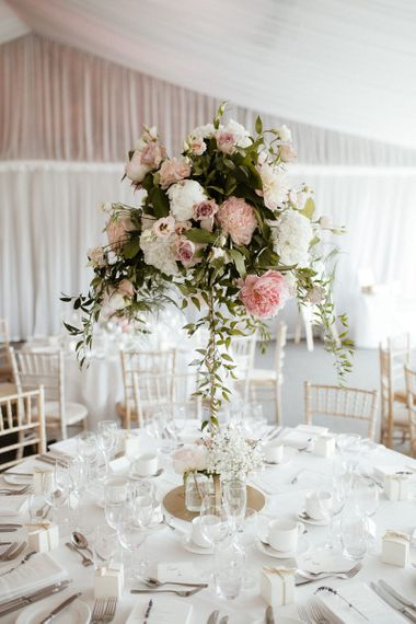 Pink wedding flower centrepieces at fusion wedding