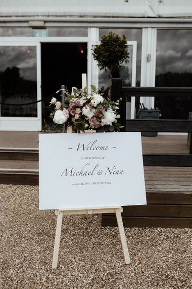 Wedding welcome sign with pink wedding flowers