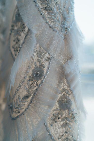 Close up details of embellished custom made Emma Beaumont bridal dress