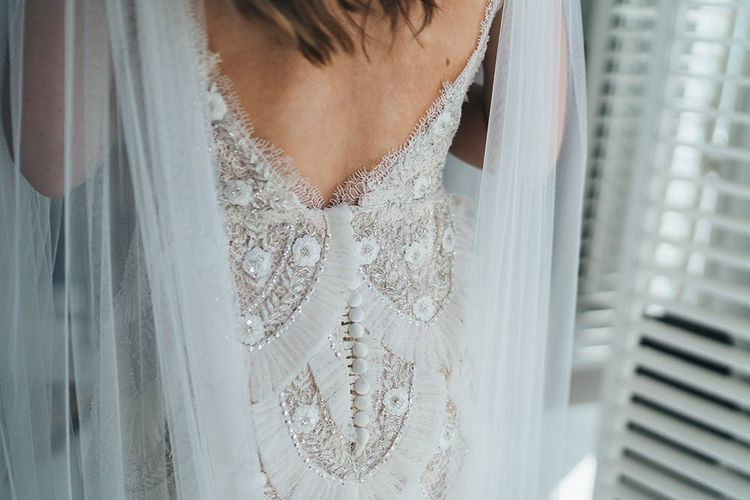 Back of brides custom made embellished Emma Beaumont dress with watteau train