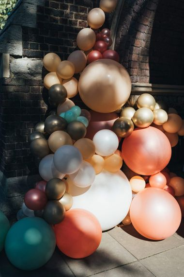 Balloon installation for relaxed autumn celebration at St Stephens Trust with peach wedding theme