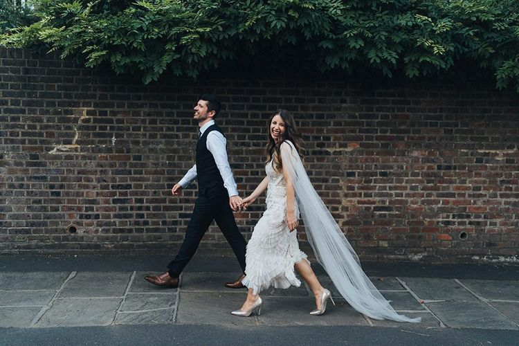 Bride and groom at relaxed autumn wedding with earthy styling, dried decor and balloon installation