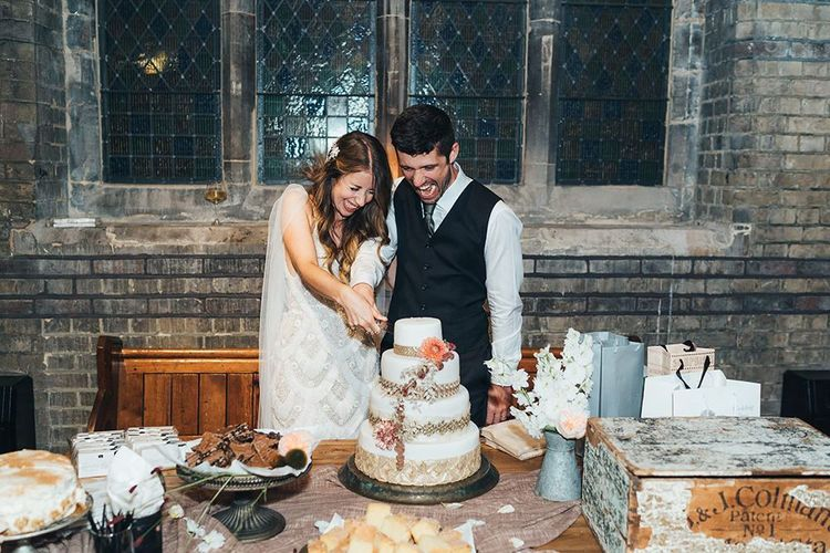 Bride and groom cut the cake at St Stephens Trust wedding reception