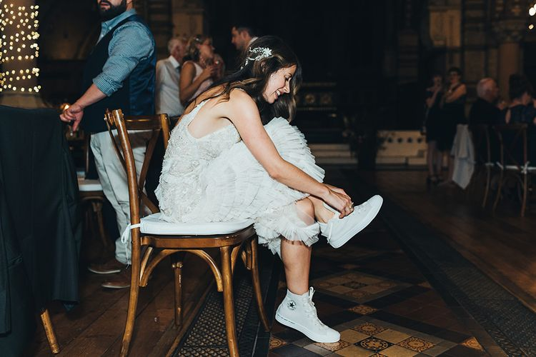Shoe change into high-top converse for the bride wearing embellished Emma Beaumont dress