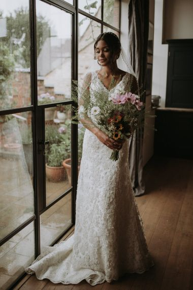Bride in lace Liliana Couture wedding dress