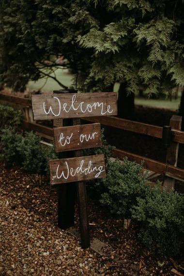 DIY wooden welcome sign at home using garden for wedding ceremony