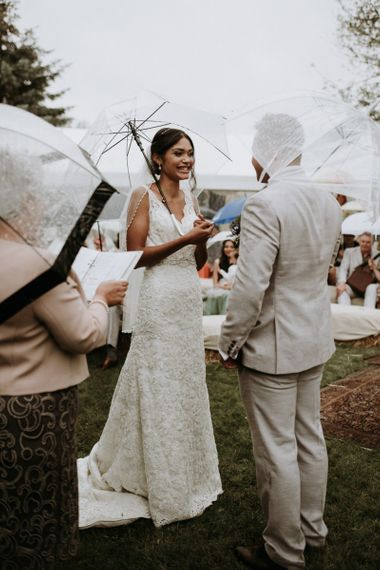 Bride and groom exchanging vows at home garden wedding ceremony