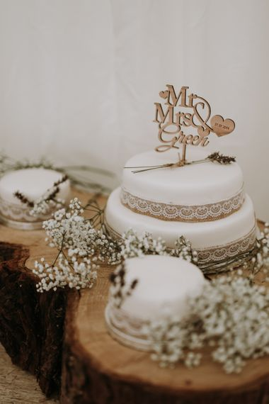 Wedding cake with burlap and lace decor in garden for wedding celebration