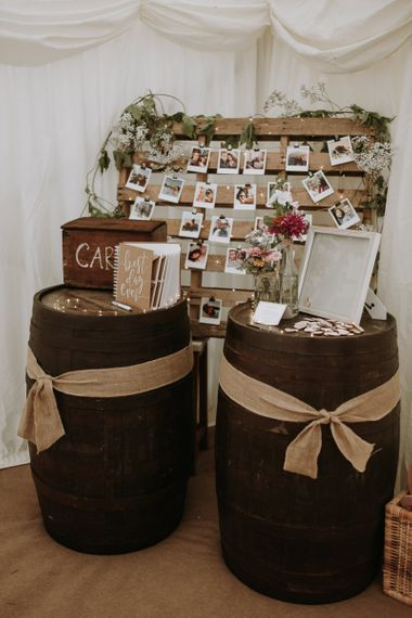 Rustic barrel card and guest book table at garden for wedding reception