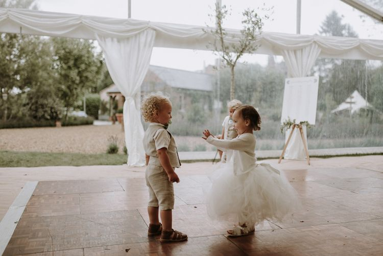 Young Page boys and flower girl on the dance floor