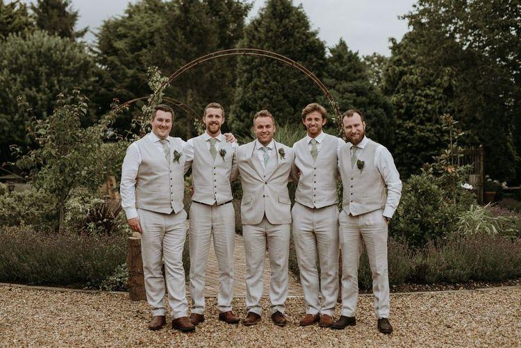 Groomsmen in beige wedding suits