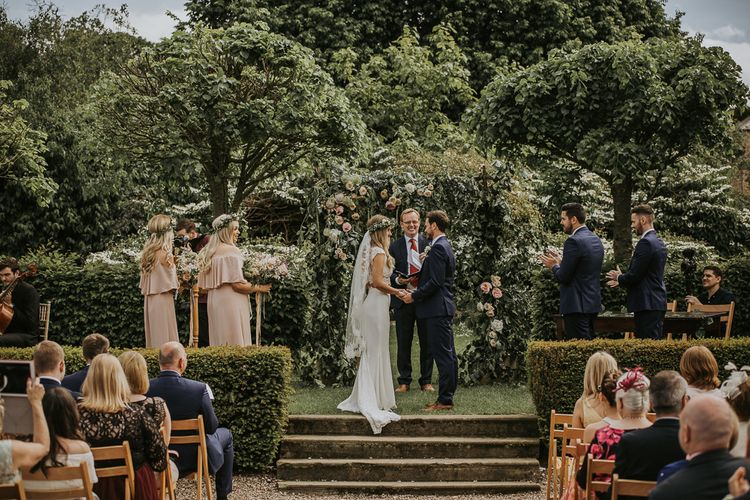 Florals by The Rose Hip and Berry // Blush Pink Boho Barn Vibes With Bride in Rime Arodaky From The White Gallery. Outdoor ceremony at Larchfield Estate in Northern Ireland. Photography by Ten Twenty One.