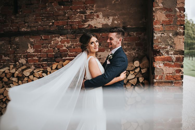 Couple shot | Veil | Blush Pink and Copper | RMW The List Members Hazel Gap Barn, Nottinghamshire | Mikaella Bridal Gown | Pear and Bear Photography