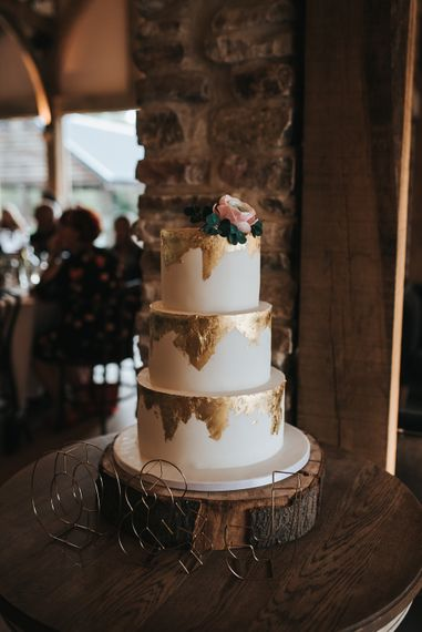 White iced and metallic foiled cake | Blush Pink and Copper | RMW The List Members Hazel Gap Barn, Nottinghamshire | Mikaella Bridal Gown | Pear and Bear Photography
