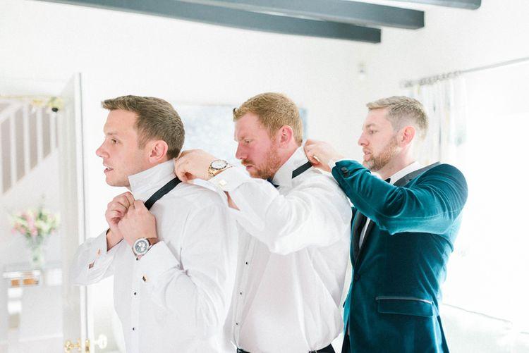 Groom preparations for wedding