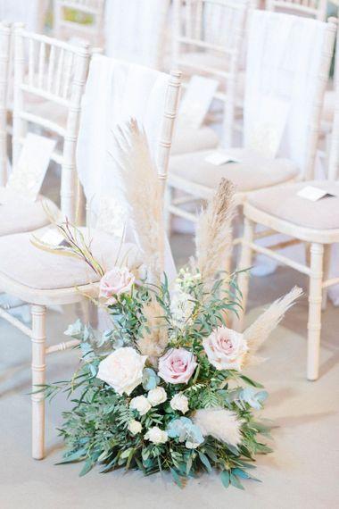 Wedding flowers and pampas grass decor for ceremony