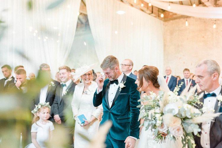 Bride in detachable skirt wedding dress greets emotional groom