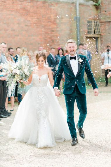 Confetti exit for bride in detachable skirt wedding dress and groom