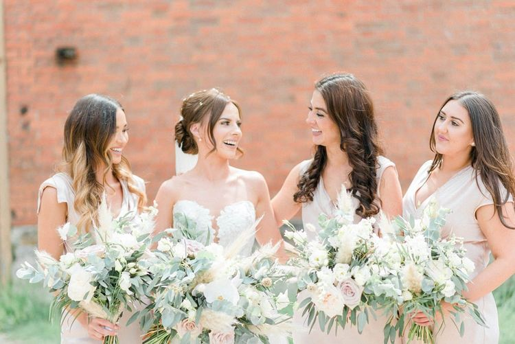 Bridal party bouquets with blush roses and pampas grass