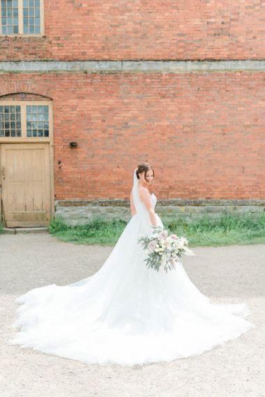 Bride in Pronovias detachable skirt wedding dress