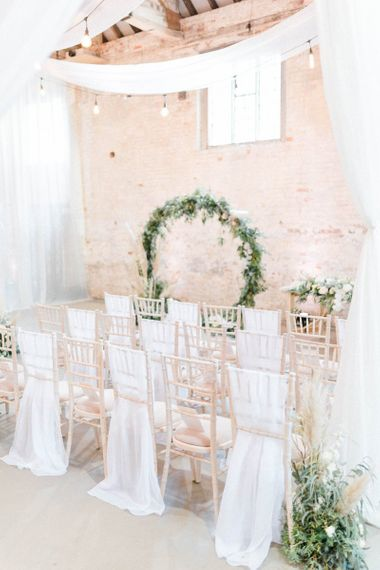 Wedding ceremony decor with moon gate at Calke Abbey