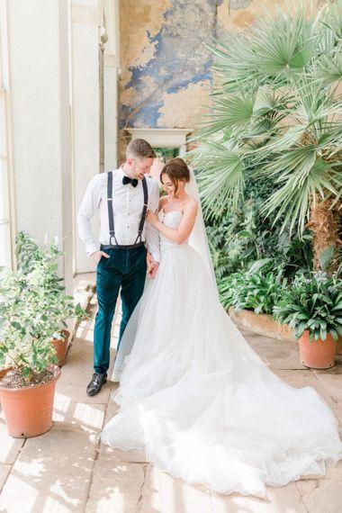 Bride in detachable skirt wedding dress with groom