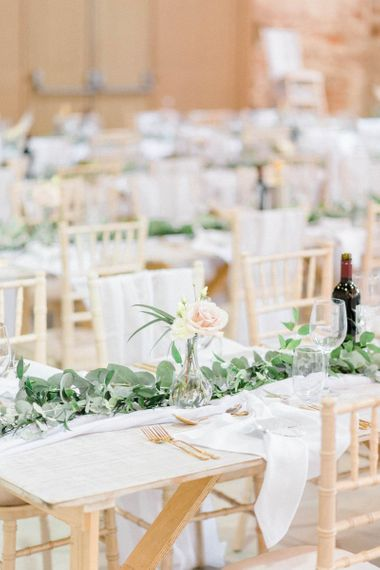 Wedding table decor with blush flowers and foliage table runner