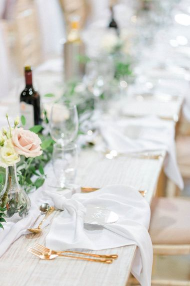 Wedding breakfast decor with foliage and flowers