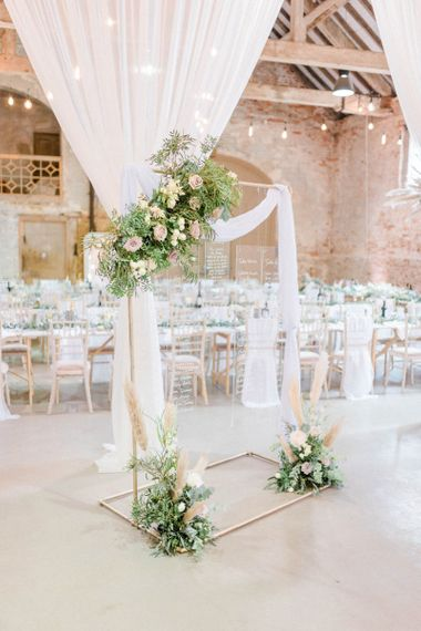 Acrylic seating plan with copper piping and flower decor