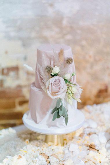 Blush wedding cake with rose flowers