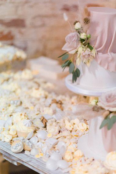 Sweet table with blush wedding cake