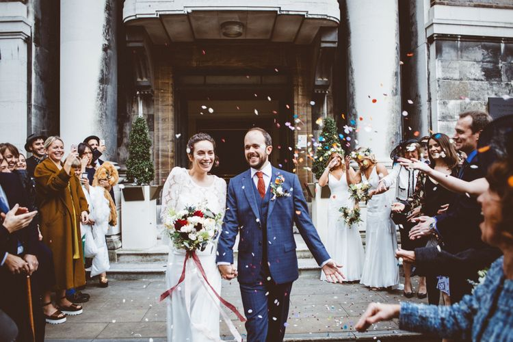 Confetti Exit | Bride in Laure de Sagazan Gown | Groom in Reiss Suit | Autumn City Wedding at Clissold House,  West Reservoir Centre | A Thing Like That Photography