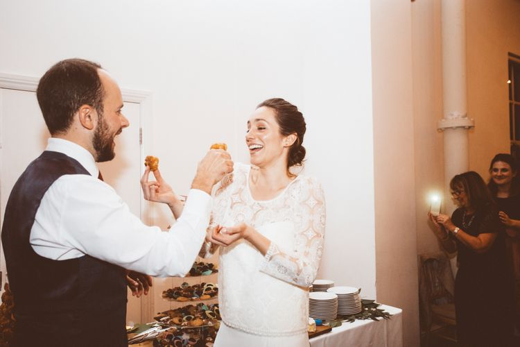 Croquembouche Wedding Cake | Bride in Laure de Sagazan Gown | Groom in Reiss Suit | Autumn City Wedding at Clissold House,  West Reservoir Centre | A Thing Like That Photography