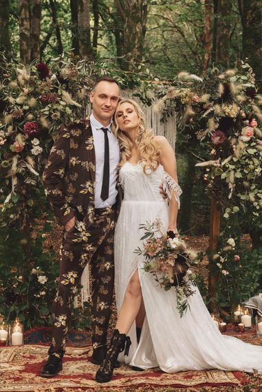 Groom in Brown Patterned Suit and Bride  Cold Shoulder Wedding Dress and Black Lace Boots
