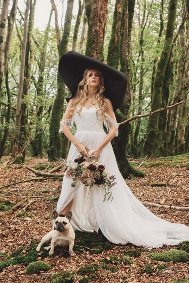 Boho Bride in Lace Wedding Dress with Giant Hat and Pet Pug