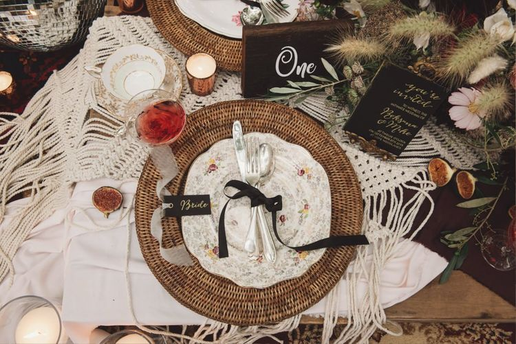Place Setting with Wicker Place Mat, Floral Plate and Cutlery Tied with Ribbon