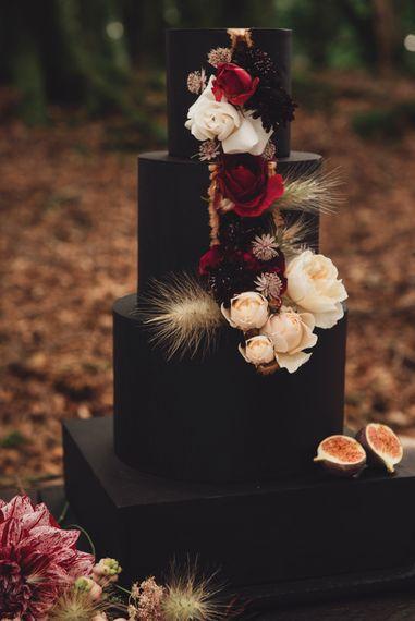 Black Square Wedding Cake with Cascading Wedding Flowers