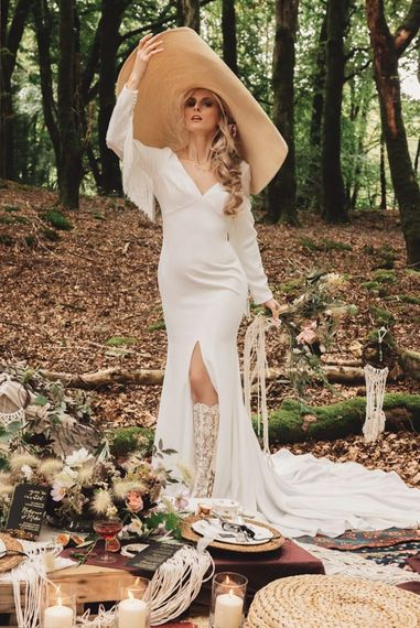 Bride in Fitted Wedding Dress with Fringe Detail and Giant Straw Hat